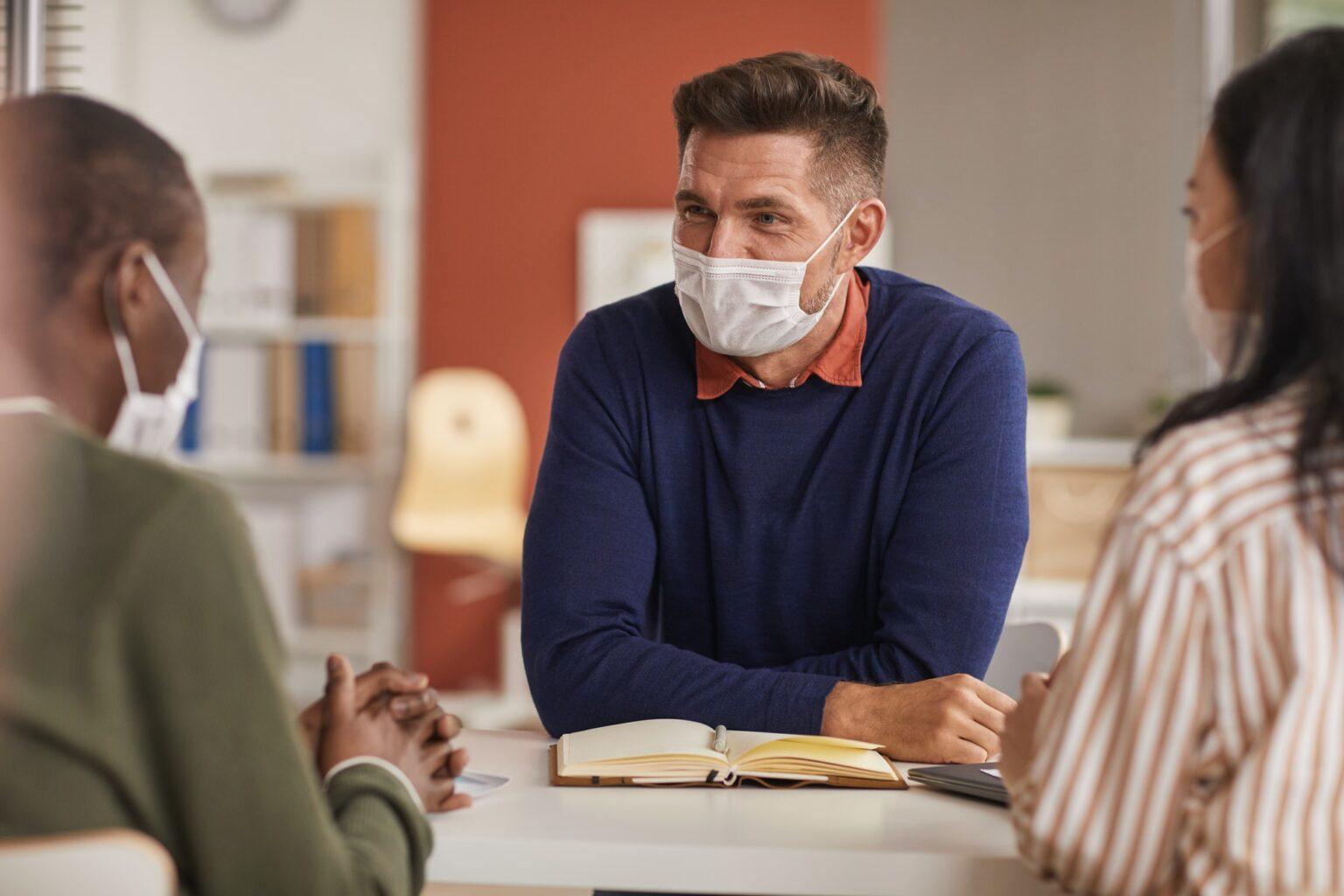 People Wearing Masks in Business Meeting